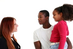 a social worker conversing with clients