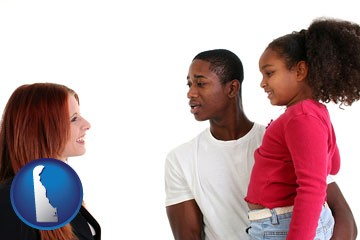 a social worker conversing with clients - with Delaware icon