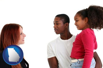 a social worker conversing with clients - with Georgia icon