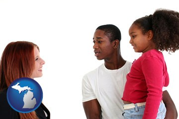 a social worker conversing with clients - with Michigan icon