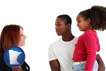 a social worker conversing with clients - with Minnesota icon